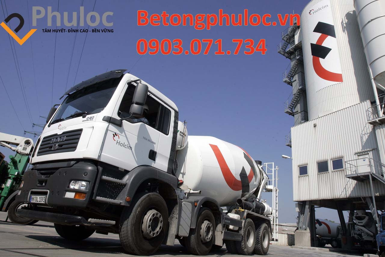 A picture containing text, outdoor, road, concrete mixer Description automatically generated